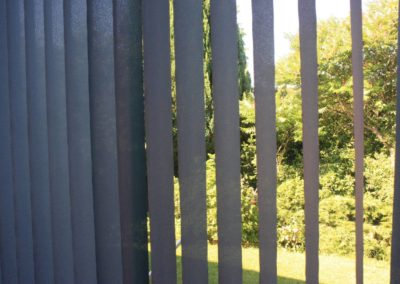 Slatted curtains Sunny garden seen from the living room
