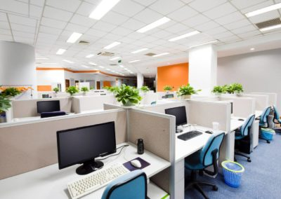 Cubicles and desks with computers in modern office