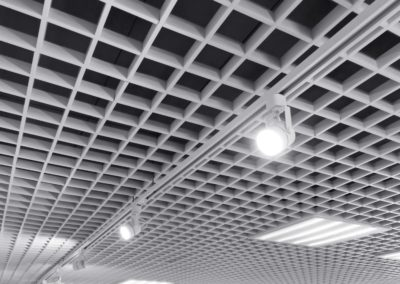 bright halogen spotlights on exhibition ceiling grid